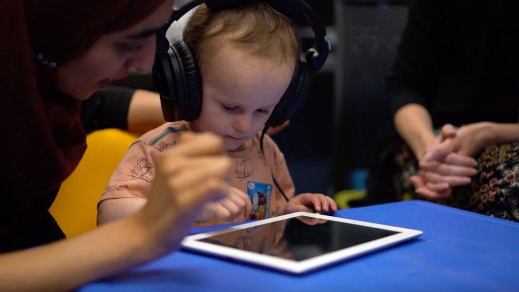 Child using Clik
